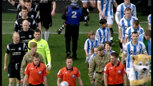 huddersfield town tribute to six british soldiers killed in afghanistan; england: west yorkshire: huddersfield: galpharm stadium: ext huddersfield... - huddersfield town football club stock videos & royalty-free footage