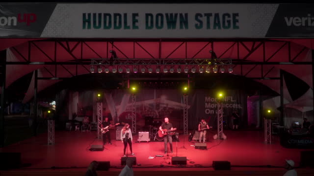 huddle down stage at super bowl live fan fest at bayfront park on january 30, 2020 in miami, florida. - performing arts event stock videos & royalty-free footage