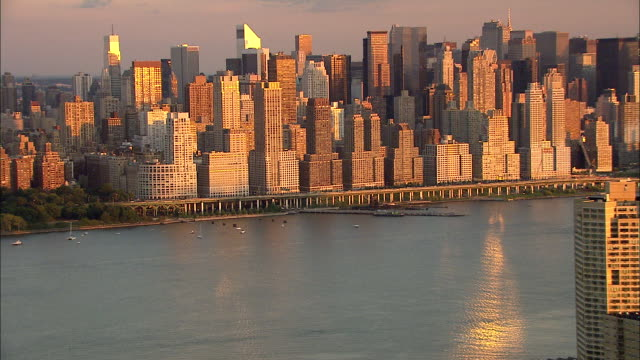 hudson river xws west manhattan skyline mid highrise apartment buildings along upper west side nyc - upper west side manhattan stock videos and b-roll footage