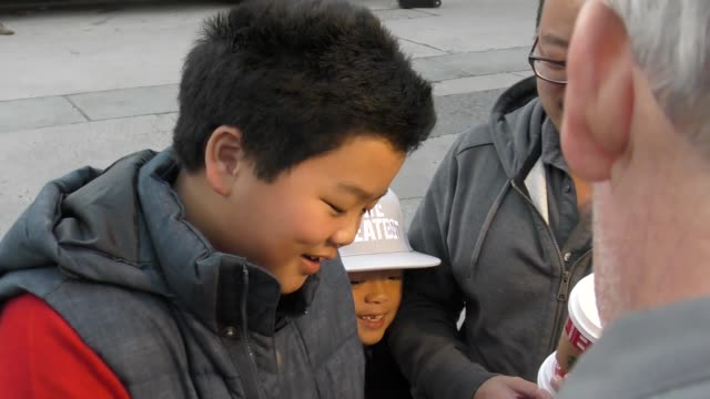 interview hudson yang talks about christmas plans on hollywood blvd at the 85th annual hollywood christmas parade in hollywood in celebrity sightings... - sfilata di natale di hollywood video stock e b–roll