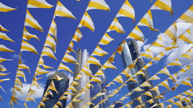 hudson yards high-rise buildings stand in blue sky behind many shaking flags by wind at new york city ny usa on may. 15 2019. - long island railroad stock videos & royalty-free footage