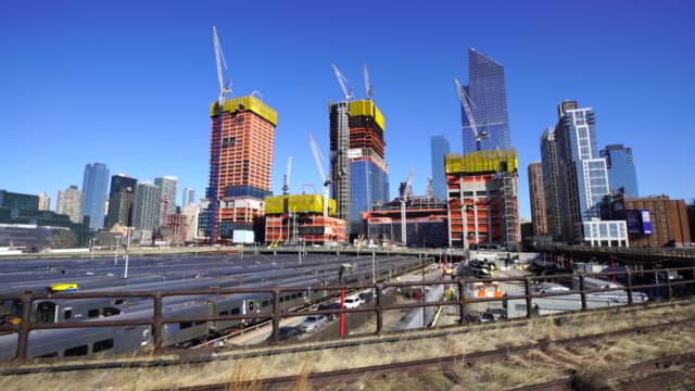 hudson yards redevelopment project is progressing at west midtown manhattan day by day on mar. 23 2017. many construction cranes work on the growing structures. - crane construction machinery stock videos & royalty-free footage