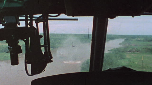 huey gunship firing grenade launcher and door gunner firing machine gun in battle along ba lai river / vietnam - vietnam war stock videos & royalty-free footage