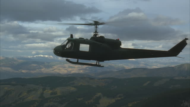 air to air, ms, huey helicopter flying over mountains - military helicopter stock videos and b-roll footage