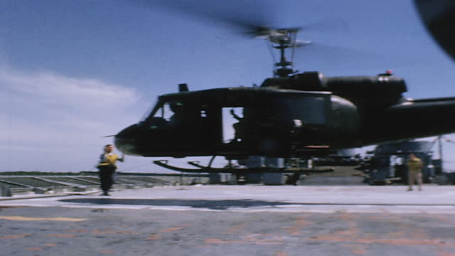 vídeos de stock, filmes e b-roll de huey helicopter lifting off from deck of uss jennings county / vietnam - formato letterbox