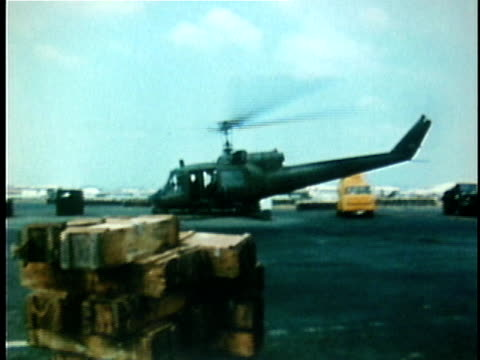 huey military helicopter taking off from air base during the vietnam war / vietnam - ベトナム戦争点の映像素材/bロール