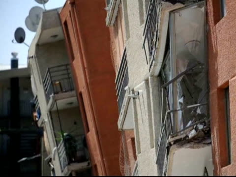 huge 8.8-magnitude earthquake rocked chile saturday killing at least 147 people, leaving a trail of twisted buildings and sending tsunami waves... - twisted stock videos & royalty-free footage