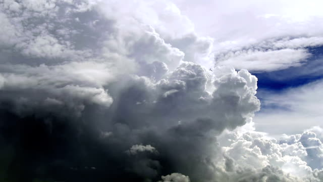 huge and tall cumulus clouds in summer sky. storm is coming. - cumulonimbus stock videos & royalty-free footage