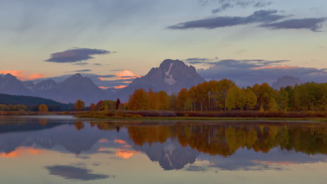 Huge banks of clouds drift above the Snake River and Oxbow Bend in Grand Teton National Park.