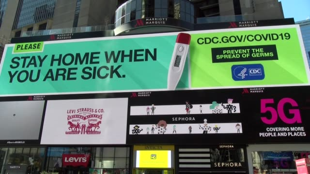 huge billboard in times square during covid-19 criosis - billboard stock videos & royalty-free footage