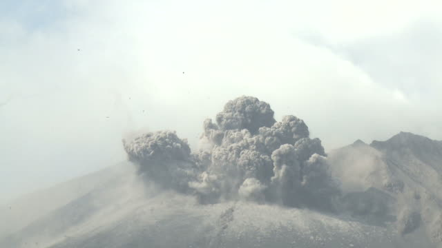 huge blast and shockwave erupt from crater of sakurajima volcano, with zoom out, january 2011, sakurajima, japan. - erupting stock videos and b-roll footage