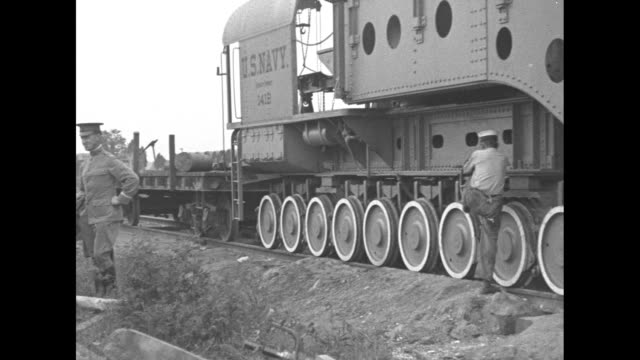 a huge cannon on tracks with workers on and around it at the indian head proving ground ten wheels on the track and military men talking at the side... - cartridge stock videos and b-roll footage