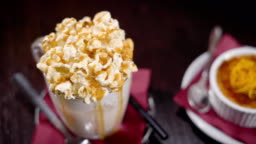 Huge caramel cocktail with popcorn topping and a dessert