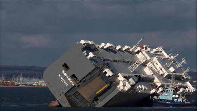 a huge cargo ship has beached off the english coast has been attracting tourists and photographers since it was deliberately ran aground on saturday... - capsizing stock videos and b-roll footage