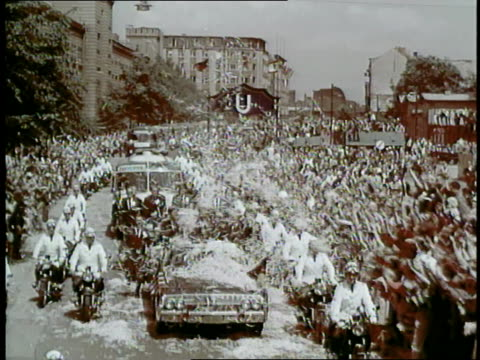 huge cheering crowds throw confetti at president john f. kennedy's car as it drives through berlin, west germany - john f. kennedy us president stock videos & royalty-free footage