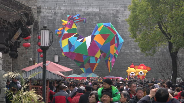 huge cockerel lantern on nanjing qinhuai lantern temple fair which is one of the oldest and biggest folk activities in china during spring festival... - chinese lantern festival stock videos and b-roll footage