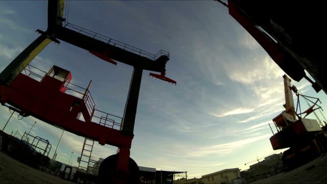huge crane for ship transport at dusk - dry dock stock videos & royalty-free footage