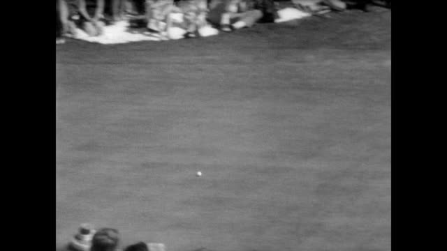 huge crowd at the augusta national golf club where the 1967 masters tournament is underway / cu jack nicklaus / cut at 36th hole and walks off with... - elimination round stock videos and b-roll footage