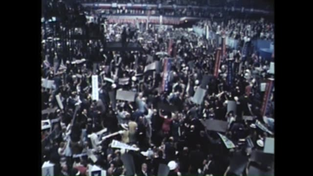 stockvideo's en b-roll-footage met huge crowd cheering and waving banners at the 1968 democratic national convention at the conrad hilton in chicago - 1968