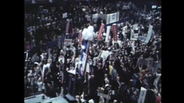 huge crowd cheering and waving banners at the 1968 democratic national convention at the conrad hilton in chicago - 1968 bildbanksvideor och videomaterial från bakom kulisserna