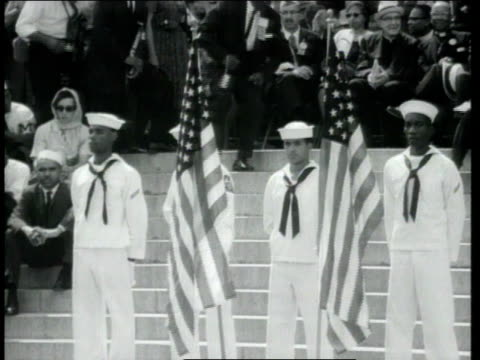 montage huge crowd gathered at washington monument as dr martin luther king jr is introduced navy men with flags marine drinking water man holding... - i have a dream 1963 speech stock videos & royalty-free footage