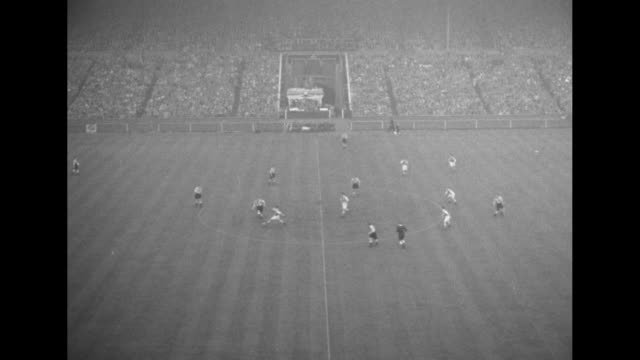 ws huge crowd in stands arms waving programs at wembley stadium to watch fa cup final between newcastle united and arsenal teams can see scoreboard... - 1952 bildbanksvideor och videomaterial från bakom kulisserna