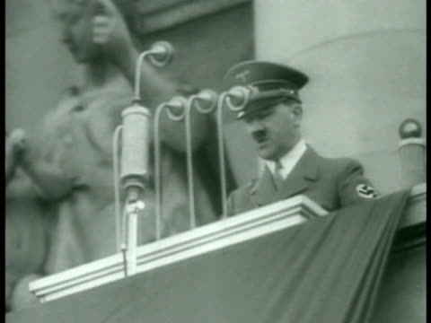 Huge crowd in Vienna waving saluting Hitler MS Crowd saluting in unison 140006 Hitler in uniform giving calm speech at podium speech continues over...