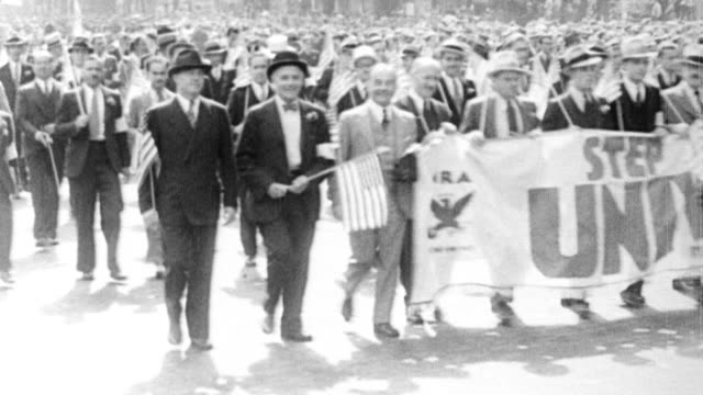 vídeos de stock, filmes e b-roll de huge crowd marches in a parade in support of the national recovery administration, one of the new deal programs created by fdr for the recovery of... - 1933