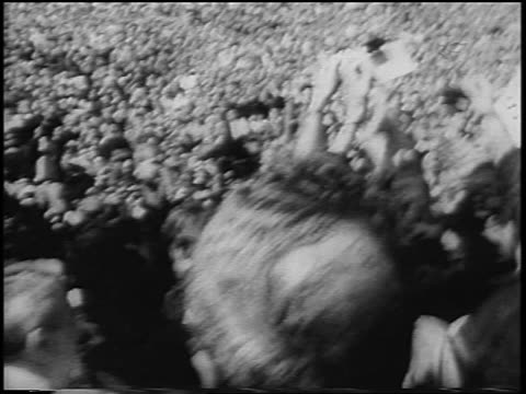 b/w 1967 huge crowd of antiwar demonstrators in kezar stadium / san francisco / newsreel - peace demonstration stock videos & royalty-free footage