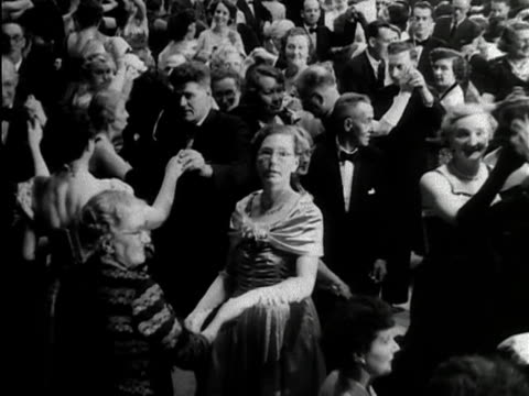 vídeos de stock, filmes e b-roll de a huge crowd of people finish dancing at the empress hall in london and applaud 1953 - traje completo