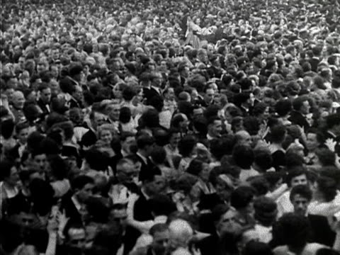 huge crowd of people perform a new dance, the waltz for a queen at the empress hall in london. 1953. - number of people stock videos & royalty-free footage