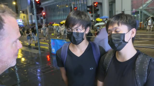 Huge crowd of prodemocracy protesters march peacefully in Hong Kong HONG Vox pops Reporter to camera SOT Low shots from puddle of protesters along...