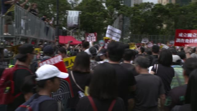 Huge crowd of prodemocracy protesters march peacefully in Hong Kong Victoria Park HONG KONG Bonnie Leung interview various shots of protesters in...