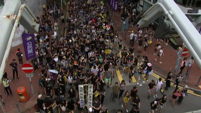 Huge crowd of prodemocracy protestors march peacefully in Hong Kong HONG High angle shot of crowd of prodemocracy demonstrators marching peacefully...