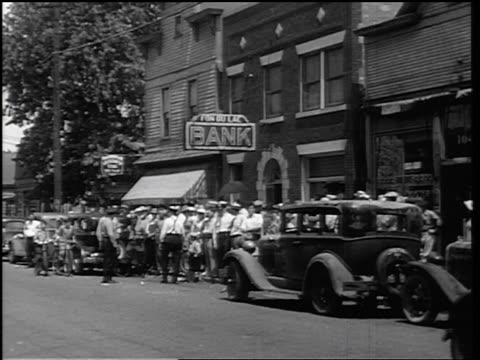 b/w 1934 huge crowd waiting outside bank on small town street / east peoria, il / newsreel - 1934 stock videos & royalty-free footage