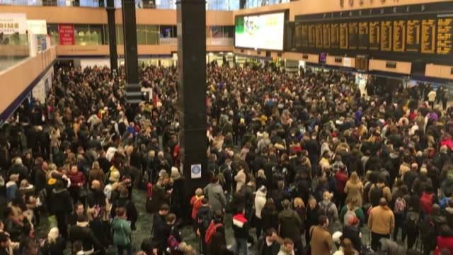 huge crowds at euston station after trains were cancelled or delayed because of storm ciara - mass stock videos & royalty-free footage