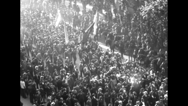 huge crowds in the street with different flags of allies as argentinians celebrate joining the league of nations / note: exact month/day not known - argentina stock-videos und b-roll-filmmaterial