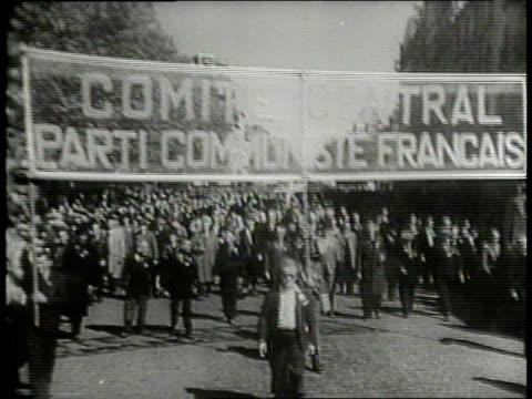 vídeos de stock, filmes e b-roll de huge crowds of communist and anticommunist demonstrators in berlin gather in both the russian and western sectors on may day to hear speeches... - 1 de maio