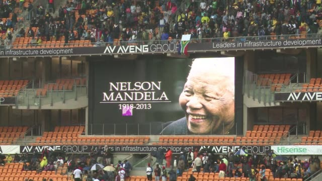 huge crowds of grieving south africans converge on soweto's world cup stadium to sit sidebyside with presidents priests queens and sheikhs at a... - soweto stock videos and b-roll footage