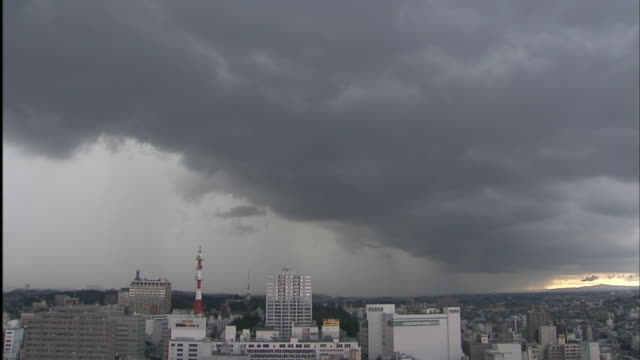 Huge dark nimbostratus clouds covering Utsunomiya city lightning striking the city caught on remotecontrolled camera on the NHK Broadcasting center...