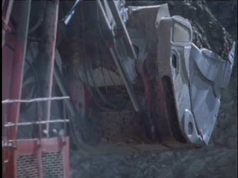 huge digger dumps coal onto lorry in coal mine uk - cabin stock videos & royalty-free footage