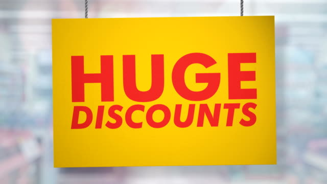 Huge discounts sign hanging from ropes. Luma matte included so you can put your own background.