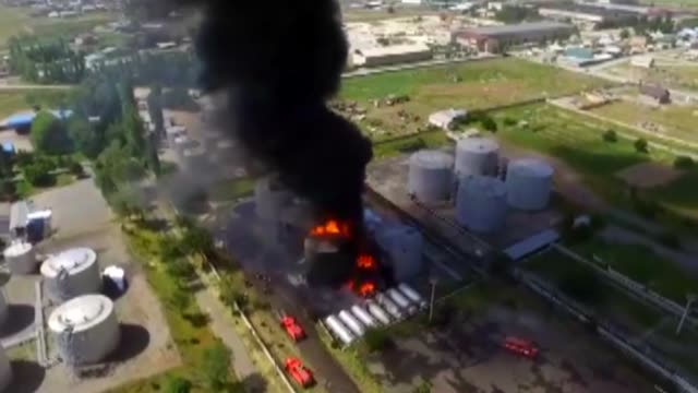Huge fire breaks out at an oil depot in JalalAbad Region southern Kyrgyzstan on May 10 2019