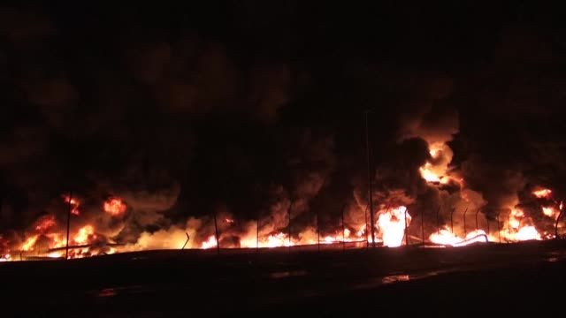 huge fire was still roaring at aden's oil refinery in the early hours of sunday after rebels shelled the nearby port to prevent a qatari ship... - aden stock videos & royalty-free footage