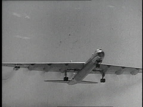 1952 MONTAGE Huge four-engine Air Force plane taking off / United States