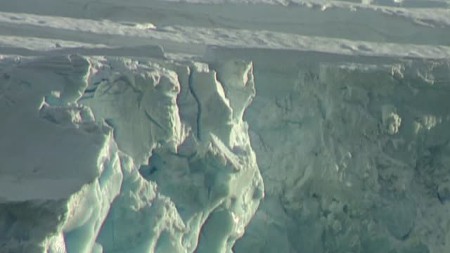 huge iceberg breaks away from larsen c ice shelf bsp030397031 / tx various shots larsen ice shelf - antarctica iceberg stock videos & royalty-free footage