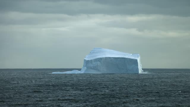 huge iceberg on arctic waters - northwest passage stock videos and b-roll footage