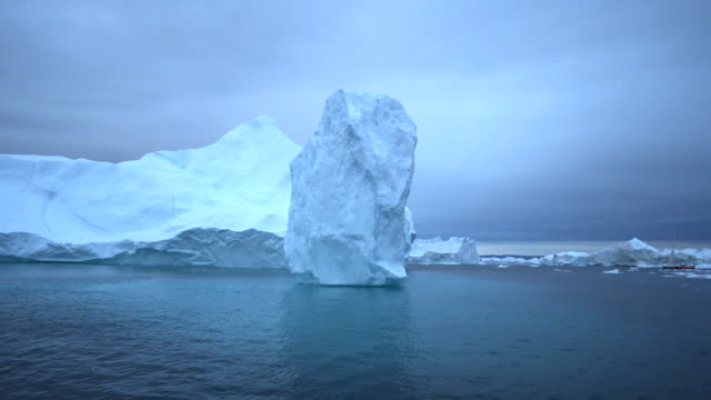 huge icebergs during sunset at disko bay - inlet stock videos & royalty-free footage