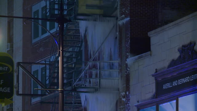 WGN Huge Icicles Cover MultiFloor Fire Escape Stairs of Storage unit warehouse in Chicago on Jan 6 2018