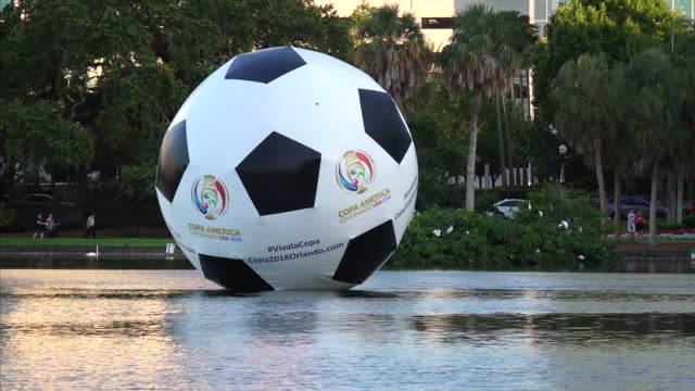 Huge Inflatable Soccer Ball Floating on Lake in Orlando, Florida
